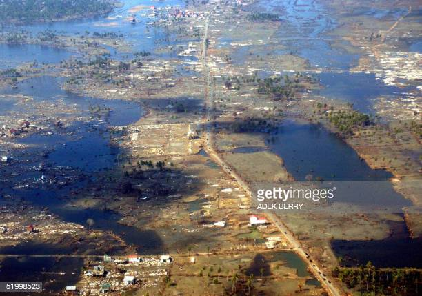 An aerial photo shows flattened houses in Banda Aceh 16 January 2005 three weeks after the deadly tsunami hit the island Hundreds of thousands of...