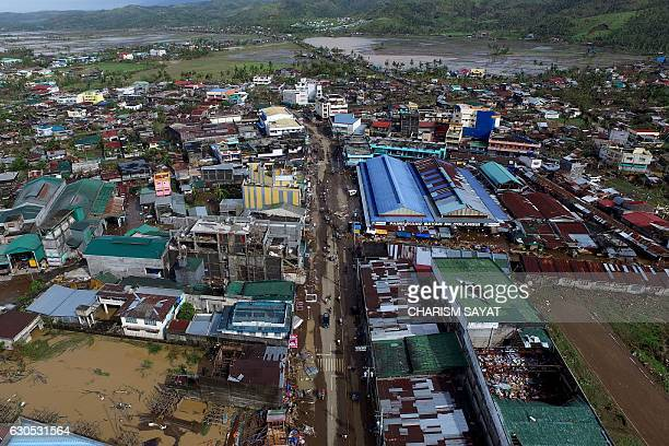 An aerial photo shows the town of Polangui after typhoon NockTen made landfall in Albay province on December 26 2016 Typhoon NockTen which made...