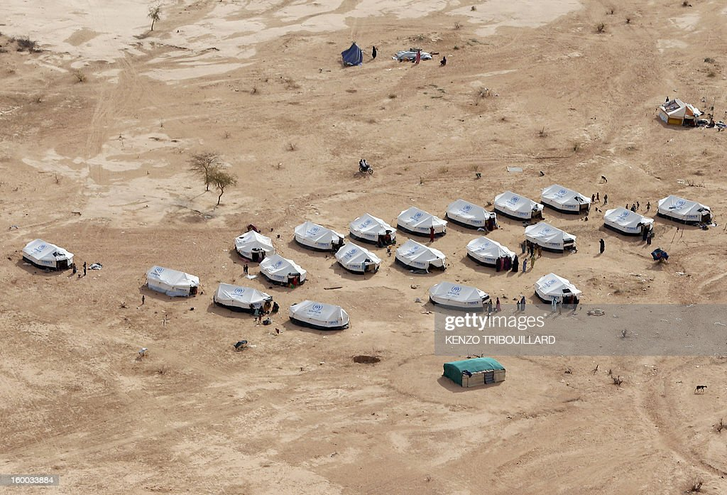 An aerial photo taken on January 24, 2013 in Menteao shows a refugee camp set near the Malian border. The conflict in Mali has caused nearly 150,000 people to flee the country, while about another 230,000 are internally displaced, the UN humanitarian agency said on January 15, 2013. According to OCHA, the UN High Commissioner for Refugees has registered 144,500 refugees in neighbouring countries -- 54,100 in Mauritania, 50,000 in Niger, 38,800 in Burkina Faso and 1,500 in Algeria.