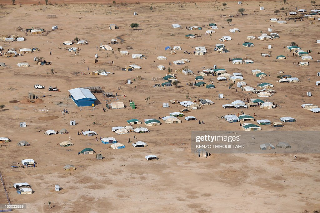 An aerial photo taken on January 24, 2013 in Menteao shows a refugee camp set near the Malian border. The conflict in Mali has caused nearly 150,000 people to flee the country, while about another 230,000 are internally displaced, the UN humanitarian agency said on January 15, 2013. According to OCHA, the UN High Commissioner for Refugees has registered 144,500 refugees in neighbouring countries -- 54,100 in Mauritania, 50,000 in Niger, 38,800 in Burkina Faso and 1,500 in Algeria. AFP PHOTO KENZO TRIBOUILLARD