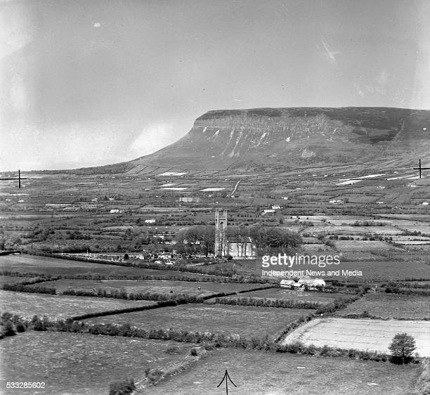 An aerial picture in which includes Drumcliffe Church and the burial ground where the remains of W B Yeats now rest Ben Bulben rises in the...