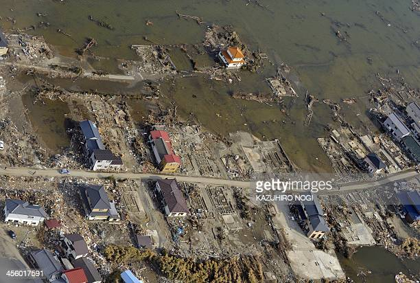 An aerial picture shows a view of flooding and vacant lots where buildings once were before the tsunami devastated the town of Ishinomaki Miyagi...