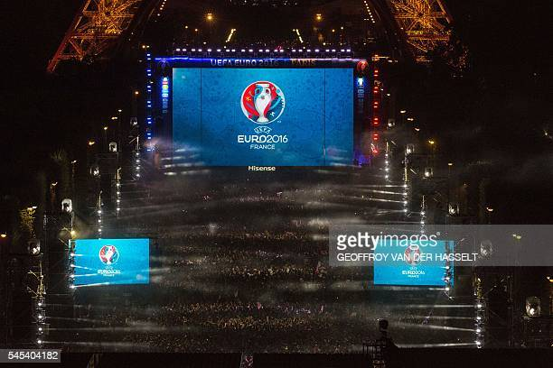 TOPSHOT An aerial picture shows a view of the Champ de Mars fan zone in Paris where France's supporters celebrate the victory of France after the...