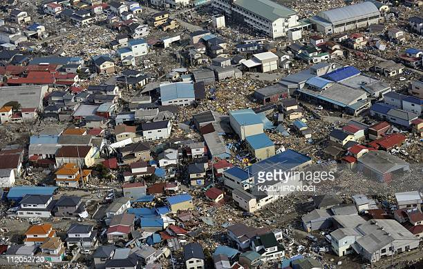 An aerial picture shows a view of the tsunami devastated the town of Ishinomaki Miyagi prefecture on April 1 2011 Thousands of Japanese and US troops...