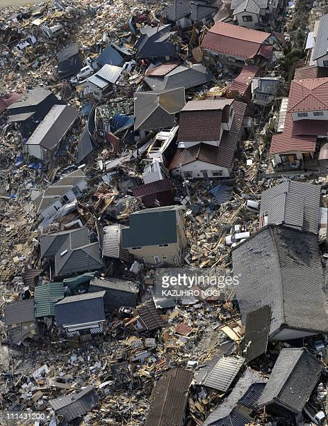 An aerial picture shows a view of the tsunamidevastated the town of Ishinomaki Miyagi prefecture on April 1 2011 Thousands of Japanese and US troops...