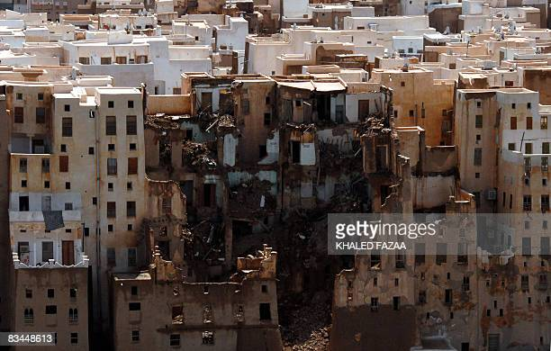 An aerial picture shows damaged buildings in the ancient city of Shibam a UNESCO World Heritage Site in the eastern Yemeni province of Hadramaut on...