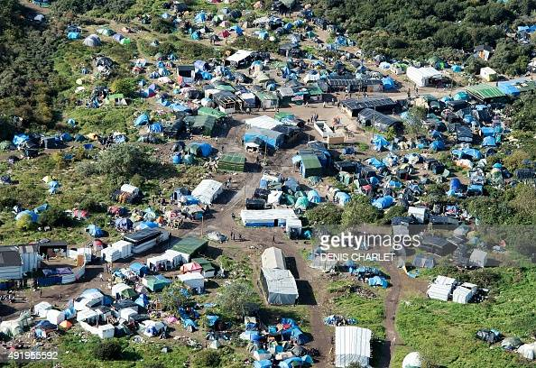 An aerial picture taken in Calais on October 9 2015 shows a site dubbed the 'New Jungle' where some 3000 people have set up camp most seeking...
