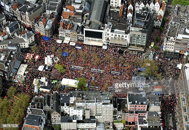 An aerial picture taken on April 30 2010 shows people celebrating the Queen's Day 2010 gathered on a main square in Amsterdam AFP PHOTO/ ANP/ BRAM...