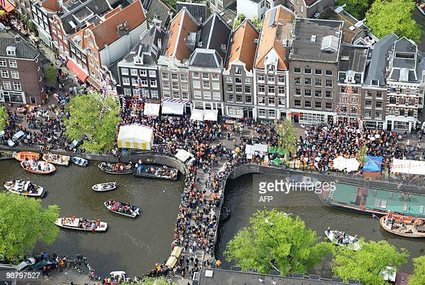 An aerial picture taken on April 30 2010 shows people celebrating the Queen's Day 2010 gathered on bridges and boats in Amsterdam AFP PHOTO/ ANP/...