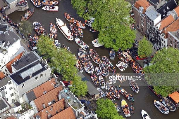 An aerial picture taken on April 30 2010 shows people celebrating the Queen's Day 2010 gathered on boats in Amsterdam AFP PHOTO/ ANP/ BRAM VAN DE...