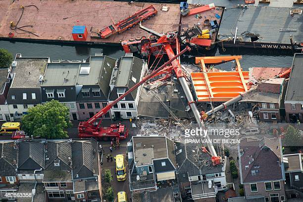 An aerial picture taken on August 3 2015 shows the two cranes that have fallen onto houses in Alphen aan den Rijn About 20 people were injured in the...