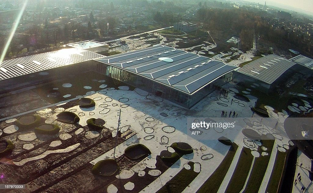 An aerial picture taken on December 8, 2012 in Lens, northern France shows the Louvre-Lens museum. The Louvre museum opened a new satellite branch among the slag heaps of a former mining town on December 4, 2012 in a bid to bring high culture and visitors to one of France's poorest areas. AFP PHOTO CEDRIC LEPILLET