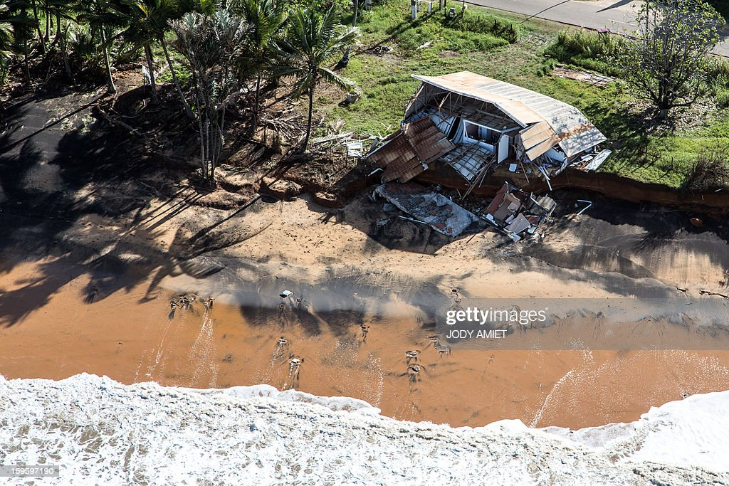 An aerial picture taken on January 15, 2013 shows a damaged rhum bar in Remire Montjoly, in the French Guiana overseas region. The coast of Guyana and several houses have been 'damaged' due to high tides. In 2001, in this place there was still a 300-400m of beach.