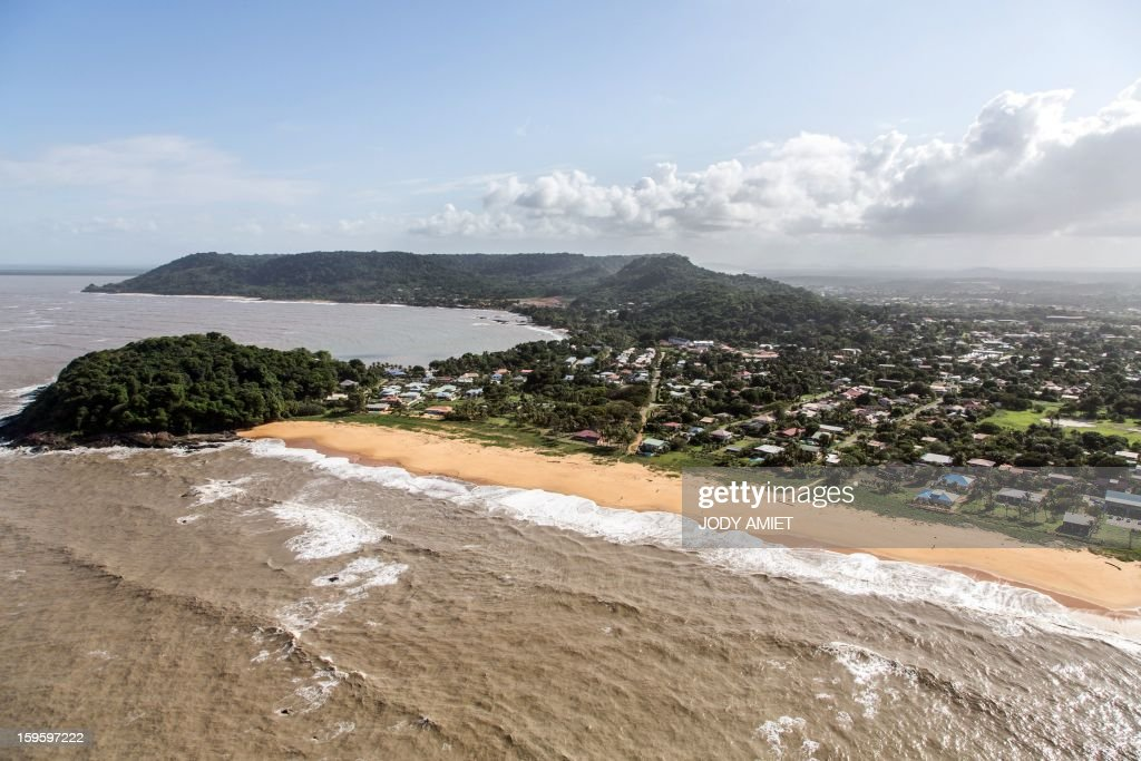 An aerial picture taken on January 15, 2013 shows the Salines beach in Cayenne, in the French Guiana overseas region. The coast of Guyana and several houses have been 'damaged' due to high tides.