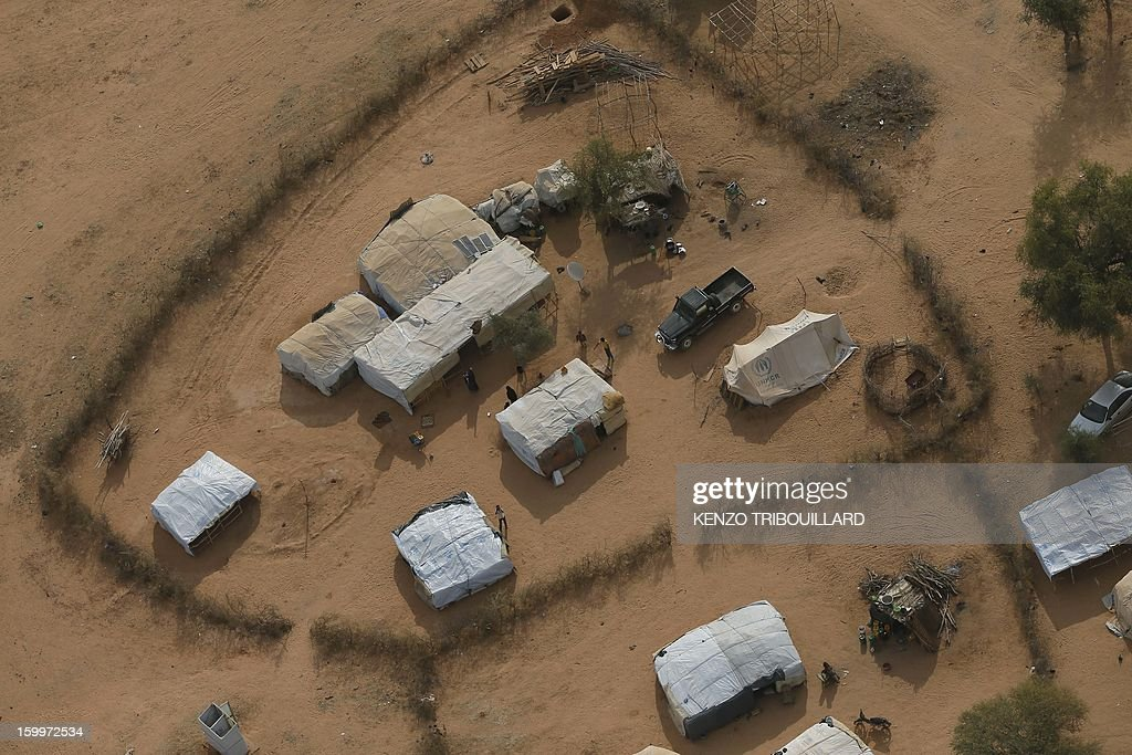 An aerial picture taken on January 24, 2013 in Menteao shows a refugee camp set near the Malian border. The conflict in Mali has caused nearly 150,000 people to flee the country, while about another 230,000 are internally displaced, the UN humanitarian agency said on January 15, 2013. According to OCHA, the UN High Commissioner for Refugees has registered 144,500 refugees in neighbouring countries -- 54,100 in Mauritania, 50,000 in Niger, 38,800 in Burkina Faso and 1,500 in Algeria.