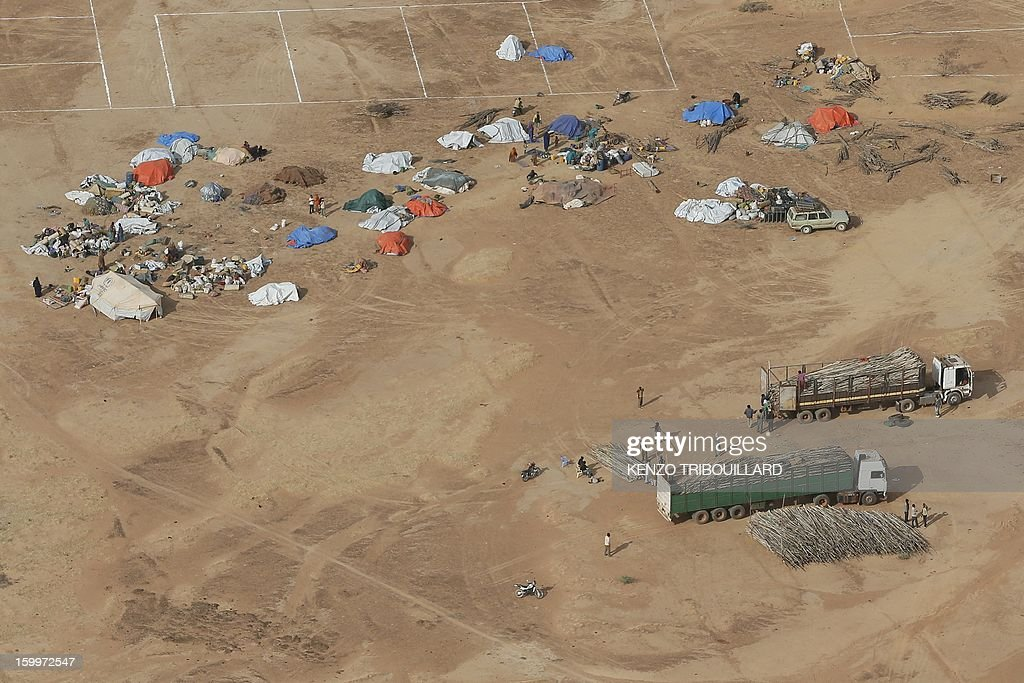 An aerial picture taken on January 24, 2013 in Menteao shows a refugee camp set near the Malian border. The conflict in Mali has caused nearly 150,000 people to flee the country, while about another 230,000 are internally displaced, the UN humanitarian agency said on January 15, 2013. According to OCHA, the UN High Commissioner for Refugees has registered 144,500 refugees in neighbouring countries -- 54,100 in Mauritania, 50,000 in Niger, 38,800 in Burkina Faso and 1,500 in Algeria. AFP PHOTO KENZO TRIBOUILLARD