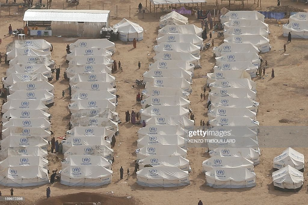 An aerial picture taken on January 24, 2013 in Menteao shows UNHCR tents at a refugee camp near the Malian border. The conflict in Mali has caused nearly 150,000 people to flee the country, while about another 230,000 are internally displaced, the UN humanitarian agency said on January 15, 2013. According to OCHA, the UN High Commissioner for Refugees has registered 144,500 refugees in neighbouring countries -- 54,100 in Mauritania, 50,000 in Niger, 38,800 in Burkina Faso and 1,500 in Algeria.