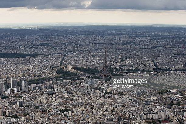 An aerial picture taken on May 28 2015 in Paris shows the Eiffel tower AFP PHOTO / JOEL SAGET