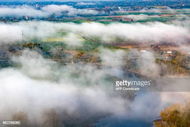 An aerial picture taken on October 17 2017 shows clouds above the countryside near Bogen southern Germany / AFP PHOTO / dpa / Armin Weigel / Germany...