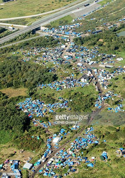 An aerial picture taken on October 8 2015 shows the 'New Jungle' migrants camp where some 3500 people live while they attempt to enter Britain near...