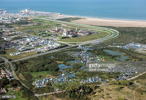 An aerial picture taken on October 8 2015 shows the 'New Jungle' migrants camp where some 3500 people live near the port of Calais protected by fence...