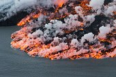 An aerial picture taken on September 14 2014 shows lava flowing out of the Bardarbunga volcano in southeast Iceland The Bardarbunga volcano system...
