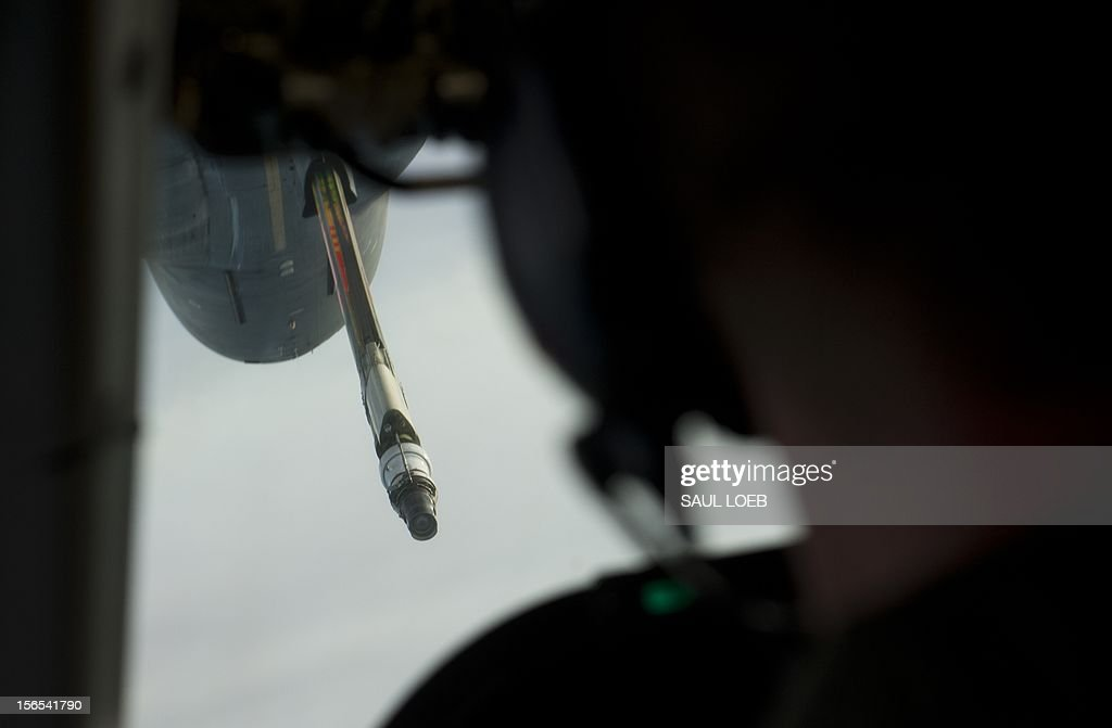 An aerial refueling tanker prepares to mate with a Boeing E4-B airplane carrying US Secretary of Defense Leon Panetta for a midair refuel as seen from the cockpit in flight over Alaska on November 16, 2012, en route to San Francisco, California. Panetta is returning from a 6-day trip to Hawaii, Australia, Thailand and Cambodia. AFP PHOTO / POOL / Saul LOEB