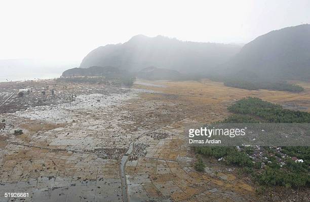 An aerial shot taken from a US Navy Seahawk helicopter from carrier USS Abraham Lincoln shows devastation caused by the Indian Ocean tsunami to the...