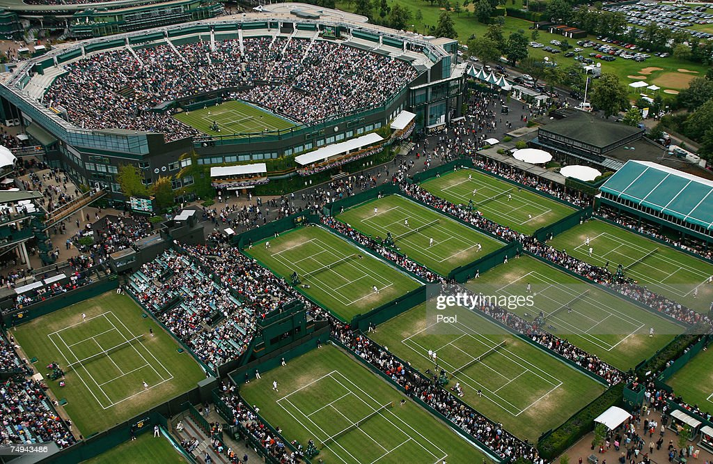 An aerial view a roofless Centre Court and the outside courts taken from the BBC elevated camera position during day four of the Wimbledon Lawn...