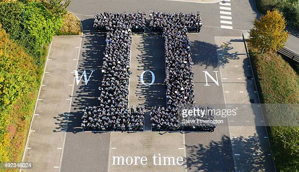 An aerial view as Mercedes teammembers spell out the number two in roman numerals as they celebrate winning their second consecutive FIA F1 World...
