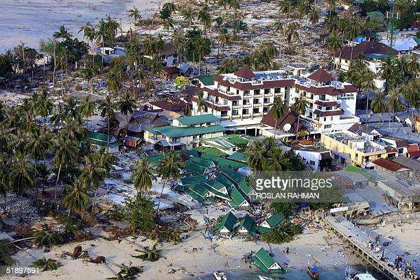 An aerial view from a helicopter shows Phi Phi hotel and its surronding on the devastated Phi Phi island in southern Thailand 28 December 2004 Over...