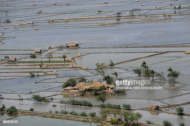 An aerial view from an Indian airforce helicopter shows a flood affected village of the Sunderbans some 100 kms south of Kolkata on May 27 2009...