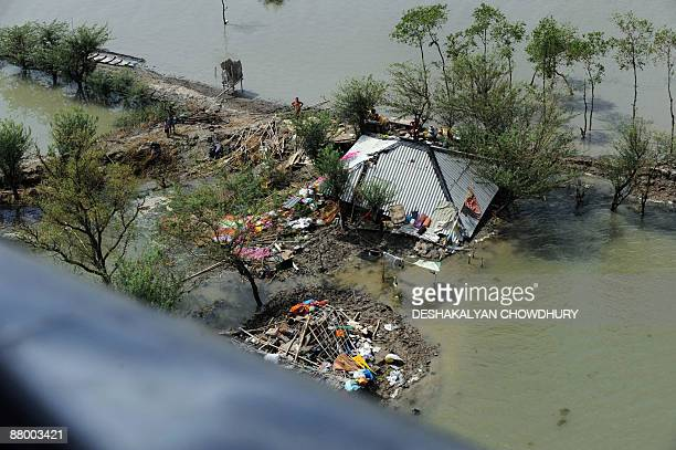 An aerial view from an Indian airforce helicopter shows damage in a flood affected village in the Sunderbans some 100 kms south of Kolkata on May 27...