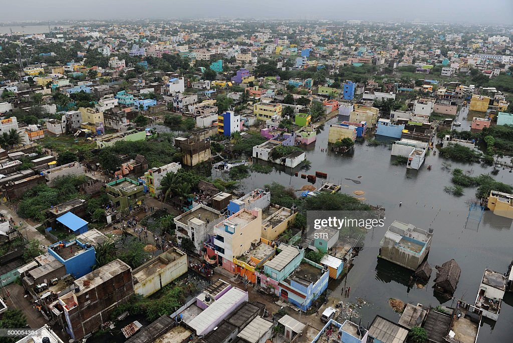 An aerial view from an Indian relief helicopter shows flood affected areas of Chennai on December 5 2015 Thousands of rescuers are racing to evacuate...