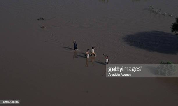 An Aerial view from taken from a helicopter shows houses are submerged in floodwater in Multan district of the Punjab province Pakistan on September...