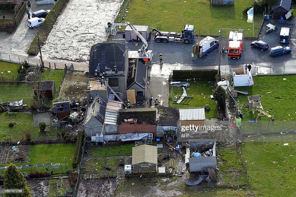 An aerial view in Oosterzele shows the destruction after a mini-tornado hit the village on February 5, 2013. The tornado hit early this morning causing damage to buildings but no casualties. LALMAND