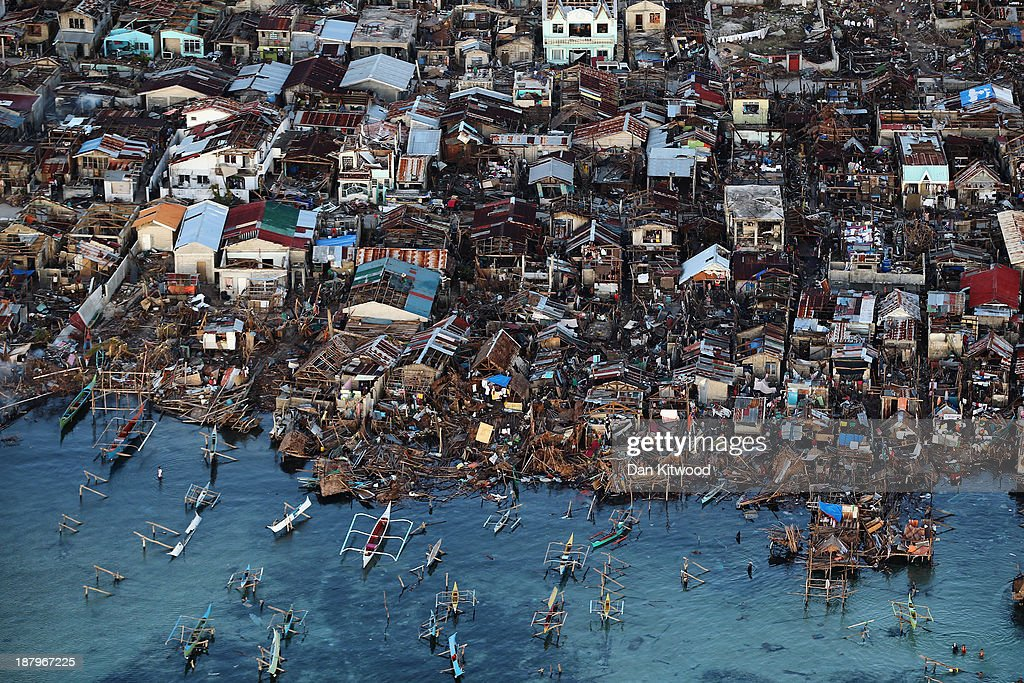 An aerial view of a demolished coastal town on Eastern Samar Island on November 14 2013 in Leyte Philippines Typhoon Haiyan which ripped through...