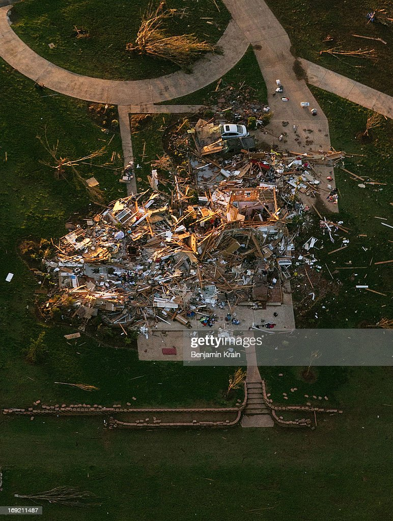 An aerial view of a destroyed house after a powerful tornado ripped through the area on May 21, 2013 in Moore, Oklahoma. The town reported a tornado of at least EF4 strength and two miles wide that touched down yesterday killing at least 24 people and leveling everything in its path. U.S. President Barack Obama promised federal aid to supplement state and local recovery efforts.