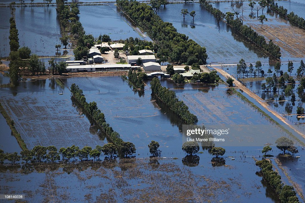An aerial view of a farm house inundated by flood waters on January 19, 2011 in Kerang, Australia. Evacuations have been ordered in several western and north-western Victorian towns as they brace for the worst flooding in over 200 years. Record rainfall has inundated the region and causing several river water levels to rise. The Victorian floods have so far claimed one life, after the body of a missing seven-year-old boy was identified yesterday.