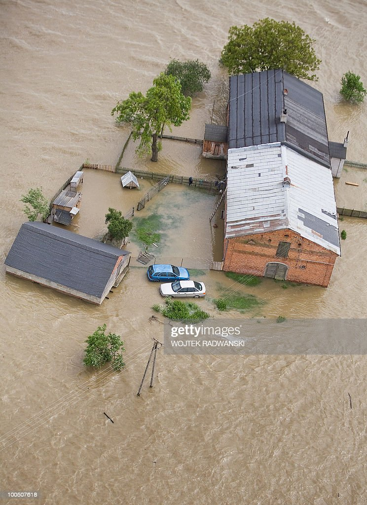 An aerial view of a flooded area of Swiniary village in central Poland at Wisla river is seen on May 25, 2010. Floods caused by torrential rains last week have swollen major Polish rivers to their highest levels in more than a century and have claimed 15 lives.