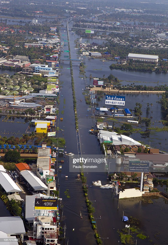 An aerial view of a flooded district just outside the capitol city November 7, 2011 in Bangkok, Thailand. Over seven major industrial parks in Bangkok and thousands of factories have been closed in the central Thai province of Ayutthaya and Nonthaburi with millions of tons of rice damaged. Thailand is experiencing the worst flooding in over 50 years which has affected more than nine million people.