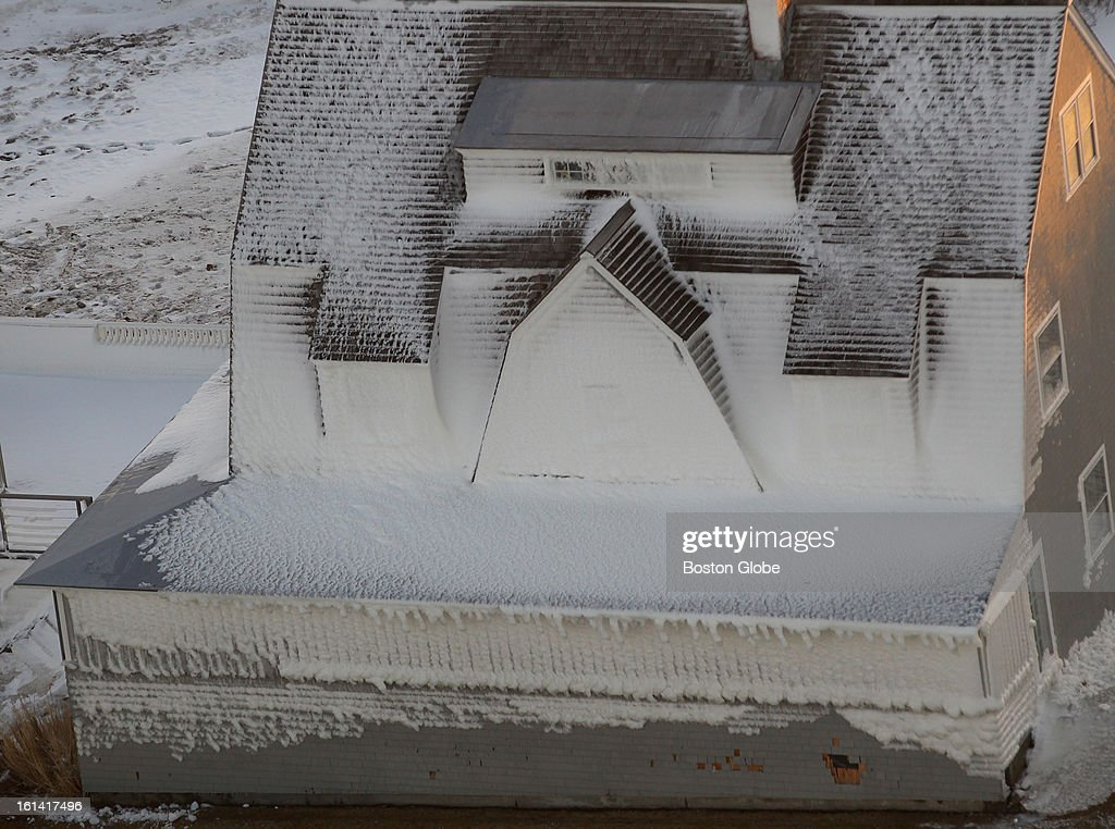 An aerial view of a home that appears to be frozen in Hull, Mass., Feb. 10, 2013. This area of the coast was hit hard by the blizzard that struck New England this weekend.