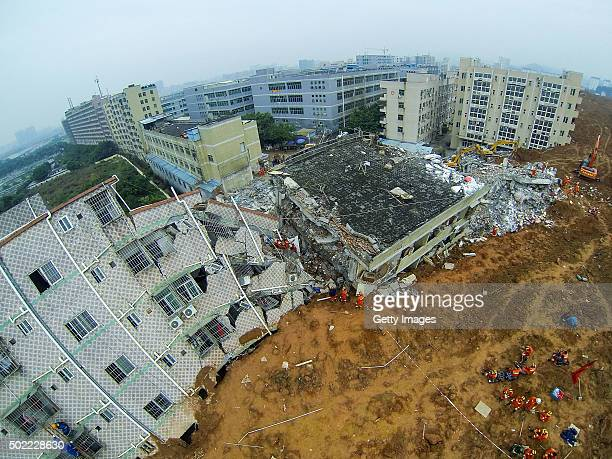 An aerial view of a landslide at Liuxi industrial park on December 21 2015 in Shenzhen China The number of missing people was revised to 85 from 91...