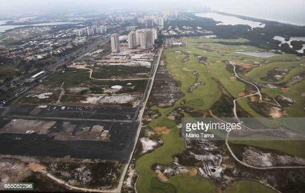 An aerial view of a partially degraded Olympic Golf Course next to vacant lots on March 17 2017 in Rio de Janeiro Brazil Seven months after the Rio...