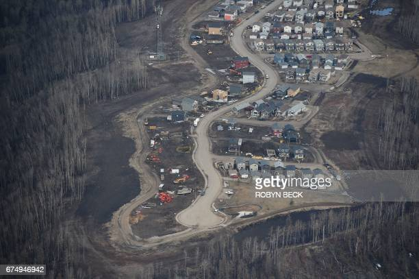 An aerial view of a residential neighborhood in Fort McMurray Canada where some homes have been rebuilt but many have not one year after the Fort...