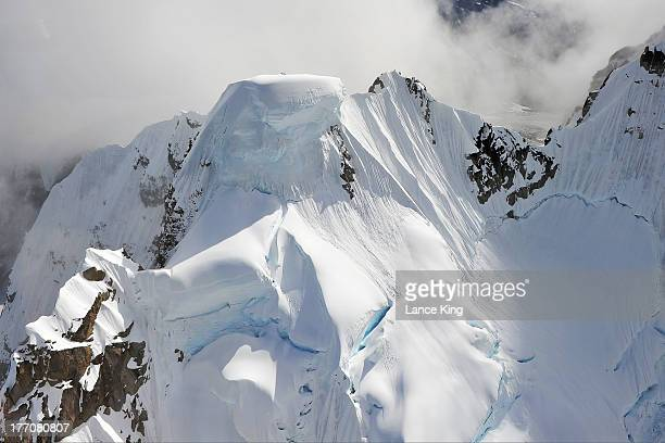 An aerial view of a snowcovered mountain peak on August 17 2013 in Denali National Park Alaska