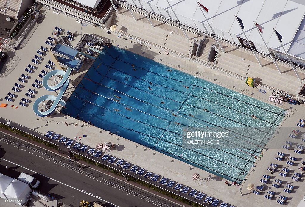An aerial view of a swimming pool on the side of a harbor, on September 20, 2013, in Monaco.