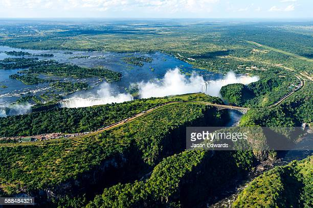 An aerial view of a winding gorge carved into a flat plain by the Zambezi River.