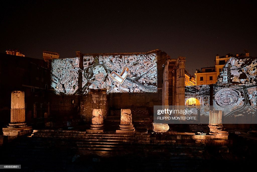 An aerial view of ancient Rome is projected on the Forum of Augustus during a 3D show in central Rome on April 21, 2014, as part of celebrations to mark the anniversary of the legendary foundation in 753 BC of the city. AFP PHOTO/ Filippo MONTEFORTE