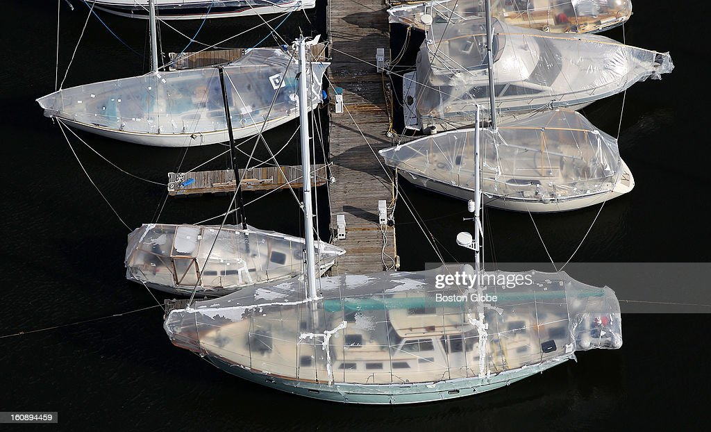An aerial view of boats docked at the Constitution Marina in Charlestown, covered in shrink wrap for the winter.